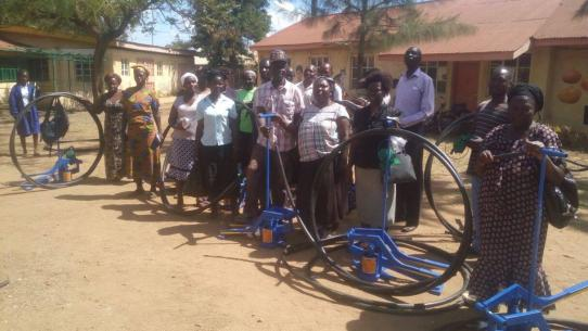 Shamba Maisha participants with farming tools